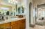 Master Bath features his and hers closets with walk in shower