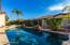 Backyard Oasis with extended covered patio and heated pool and spa!