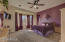 Large, cozy master suite w/bay windows.