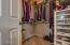 Walk in closet w/ plenty of storage.