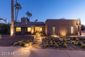 The Iron Sculpture Garden and Barrel Cactus Forest lend to this properties great curb appeal!!