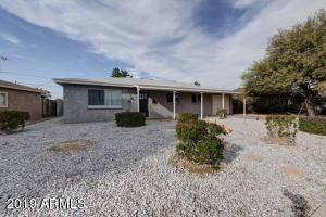 This Central Phoenix gem offers a turn-key, remodeled space in a convenient location, near I-17 freeway, Encanto Park, and Phoenix College! The home is designed with all of the features the modern buyer is looking for, including wood-look tile flooring, shaker cabinets, quartz counter tops, barn doors, dual pane windows, gray and white color palette, and an open concept floor plan. Every inch of space has been updated and is ready for your personal touches! With a low maintenance backyard and garage, this home has everything you need.