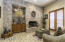 Great room with gas fireplace & beautiful stone wall