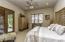Master bedroom suite with doors to courtyard/ patio