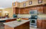 Kitchen with Granite Countertops. Stainless Appliances, Smoothtop Electric Range and Built-in Microwave