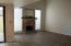 Imagine Your Furniture here! Enjoy the gorgeous and light Great Room, with adjoining Dining Room- including plumbing in the Great Room cabinet, for a wet bar, plus 2 doors leading to the back patio!