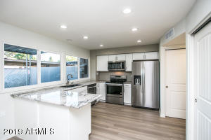 renovated kitchen , raised celinings, new cabinets, pantry doors, applicances, granite counters and undermounted composite sink