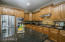 The beautifully upgraded Kitchen provides a gas cook top, built in Oven, Microwave and Refrigerator.