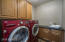 The downstairs laundry is off the garage and has extra cabinets for storage.