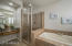 The Master Bathroom provides a separate vanity soaking tub, and upgraded shower.