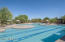 The pool and spa is heated year round and surrounded by shade.
