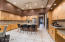 The kitchen island has seating options and drop pendant lighting.