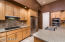 The kitchen has amazing storage in addition to a walk in pantry.