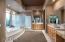 This very generous master en suite bath features separate vanities.