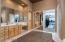 Full mirror doors lead into the master closet through the bath.