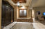 Dramatic entry foyer with accent colors and lighting options.