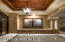 Enter into the foyer with coffered ceilings.