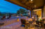 Spacious covered patio ideal for poolside dining or stargazing.