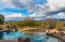 The nearly one acre of land provides privacy and natural Sonoran desert beauty.