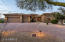 Circular driveway and three car garage offers convenient parking options.