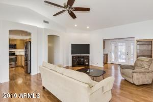 Welcoming Living Space with vaulted ceilings, canned lighting, nice fans.