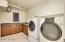 Located upstairs; washer & dryer convey; electric connection