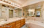 The master bathroom gives you dual sinks, nice lighting, and separate tub & shower.
