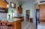 Open kitchen with granite counters/custom cherry cabinets