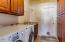 Laundry room with added cherry cabinets, granite counters and utility sink