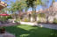 Queen palm, tipu and plum trees shade your forever-green patio and yard