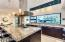 """Large center island with 3"""" granite counter top. Poggenpohl cabinets & custom Atelier hood"""