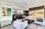 Living room glass walls open on two sides to patios. Kitchen features sink, dishwasher, ice maker, two refrigerators & Microwave