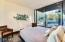 Wall of glass provides view of pool. Custom made bed will convey