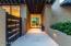 Large glass door provides view through to resort backyard