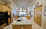 Soaring ceilings throughout. Kitchen overlooking courtyard