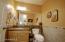 Powder room, granite countertop and decorative tile.