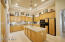Kitchen, under cabinet, above cabinet and pendant lighting.