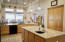 Chef's kitchen with TWO islands and TWO sinks to craft some divine gourmet meals!