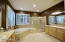 Master bathroom, dual vanities, and separate walk-in shower and jetted tub