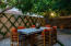 Dine In The Divine Backyard With Citrus Trees, Custom Water Feature, & Fire Pit