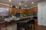 Quartz Kitchen Island With Under Lighting & Stacked Stone