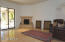The family room is just off the kitchen and has a wet bar and exits to the rear patio & pool area.