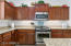 Kitchen with Stainless Applicances, Gas Range and Granite Countertops