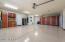 Abundant Custom cabinetry and epoxy flooring finish the garage