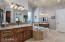 Comfort height dual vanities with furniture grade cabinetry.