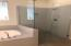 Master Retreat offers upgraded large subway tile surround at Tub and Shower. Shower doors are rimless.