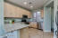 Slab granite and stainless steel appliances.