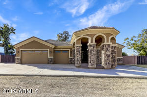 Gorgeous Custom Home on 1 acre irrigated lot with Guest house...total of 4710sf!
