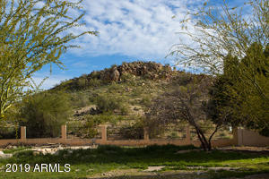 This stunning lot backs/sides one of the prettiest mountains in Ahwatukee. Craggy rocks and beautiful sunsets!