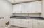 Full Size Laundry with Custom Cabinetry and Inside Laundry with Gas Dryer Hookup